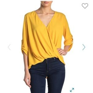 Lush surplice draped high/low blouse